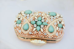 Gold Turquoise Wedding Clutch. Elegant rose gold wedding clutch for the bride with turquoise teal gemstones and pearls Stock Photos