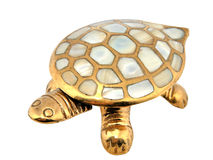 Gold turtle. Mother-of-pearl armour. Decoration from India Royalty Free Stock Photos