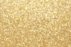 Gold twinkling light background Royalty Free Stock Image