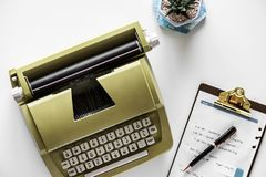 Gold Type Writer Beside Clip Board and Click Pen Stock Images