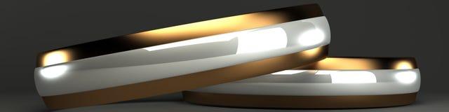 Gold- und der silbernen Hochzeitringe 3d Lizenzfreie Stockfotografie