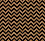 Gold- und des schwarzen Zickzacksnahtloses Vektormuster lizenzfreie stockfotografie