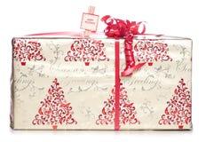 Gold und rotes Weihnachtsgeschenk Stockbild