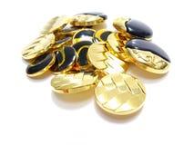 Gold und schwarze Knöpfe Stockfotografie