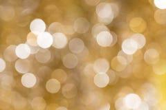 Gold unscharfes abstraktes bokeh backgound Lizenzfreies Stockfoto