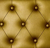 Gold upholstery leather background Royalty Free Stock Images
