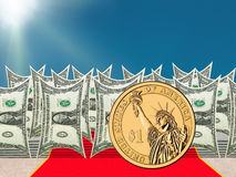 Gold US Dollar standing out of Dollars notes characters. The gold US Dollar with the Statue of Liberty on it is shining and standing out of the US Dollars notes Stock Photo