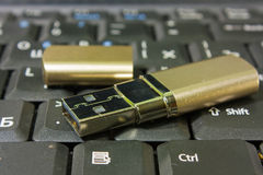 Gold USB disk and keyboard Royalty Free Stock Photo