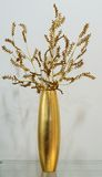 Gold vase with gold flower Royalty Free Stock Photography