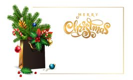 Gold Vector hand drawn lettering text Merry Christmas. 3d Shopping bag, bouquet spruce, fir branches, xmas toys, colorful balls,. Holly berries, leaves, sweets stock photography