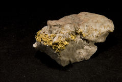 Gold vein. A vein of gold embedded in granite and quartz Stock Photo