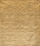 Gold Velvet with Embossed Vintage Pattern Fabric Swatch. Gold velvet fabric with embossed vintage pattern swatch Stock Photo