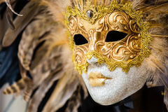 Gold venetian mask in Venice, Italy. Detail of a traditional venetian mask in Venice Stock Images