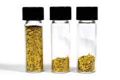 Gold. Vial Glitter Gold harvested in river Royalty Free Stock Photo