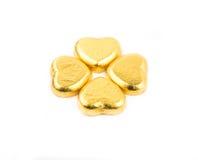 Gold vier Herzschokoladen lizenzfreie stockbilder