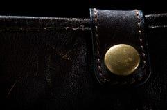 Gold vintage button on a dark background Stock Photo
