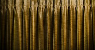 Gold vintage curtains background. Stock Photo