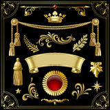 Gold vintage decorative design elements isolated on black. Royalty Free Stock Image