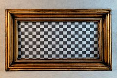 Gold vintage frame, chess Board background. royalty free stock image