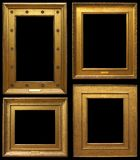 Gold Vintage Frames. Gold vintage picture frames isolated on black background Royalty Free Stock Photo