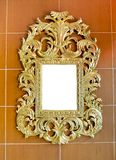Gold vintage mirror isolated on brown tiles background Royalty Free Stock Images