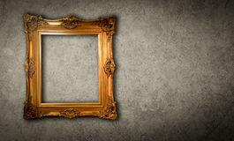 Gold vintage photo frame gray background.  Stock Photo