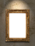 Gold vintage photo frame on grunge wall Stock Image