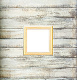 Gold Vintage picture frame on old wood background Stock Images