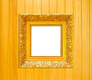 Gold Vintage picture frame on wood background Stock Photography