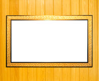 Gold Vintage picture frame on wood background Stock Photos