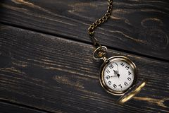 Gold vintage pocket watch. On a wooden table. Old time background. Top view Royalty Free Stock Photo