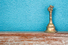 Gold vintage retro bell on wooden table Royalty Free Stock Photo