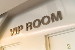 Gold VIP room sign in front of the room with warm light effect for special guests. Attending the meeting stock photos