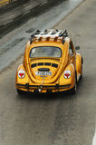 Gold Volkswagen Beetle. Vintage car at the city street Royalty Free Stock Photos