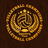 Gold volleyball emblem on the wooden texture Stock Image