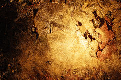 Gold wall. A wall painted of gold, realistic gold texture Stock Image