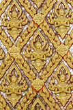 Gold wall laithai of temple at thailand Stock Images