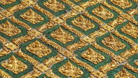Gold wall laithai of temple at thailand. Thai pattern wall of Thai temple royalty free stock photos