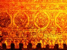 Gold wall of stupa in Myanmar. A gold leaf pattern on the wall of old stupa (Mandalay, MyanmarA). Would make a good grunge background Royalty Free Stock Image