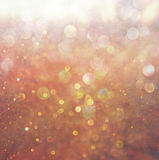 Gold and warm abstract bokeh lights. defocused background. Royalty Free Stock Photography