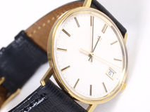 Gold watch. On white in studio Stock Photography