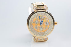 Gold watch with diamonds Royalty Free Stock Images