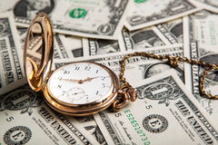 Gold watch and dollar bills Royalty Free Stock Photo