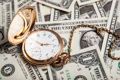 Gold watch and dollar bills Royalty Free Stock Images