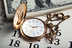 Gold watch and dollar bills Royalty Free Stock Photography