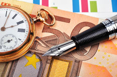 Gold watch and euro bills Royalty Free Stock Photography