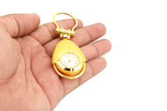 Gold watch in hand on isolated Royalty Free Stock Photography