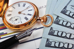 Gold watch, ink pen and dollars Royalty Free Stock Photography