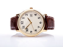Gold watch leather strap. Gold watch with leather strap . Brown leather strap and white face Royalty Free Stock Image