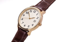 Gold watch leather strap. Gold watch with leather strap isolated. Brown leather strap and white face stock photography